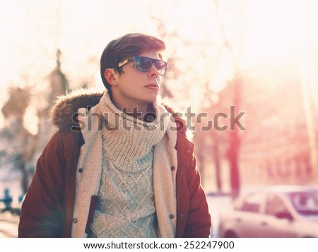 Fashion, clothes and people concept - portrait of stylish young man in sunglasses outdoors - stock photo