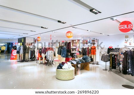 fashion clothes shopfront in shopping mall - stock photo