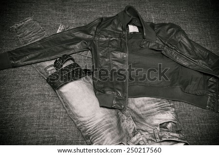 fashion clothing for brutal men: leather jacket, jeans, a leather belt with a buckle