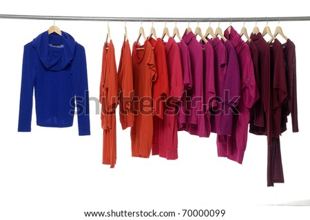 Fashion clothing hanging on hangers - stock photo