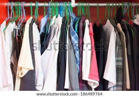 fashion clothing on hangers - stock photo