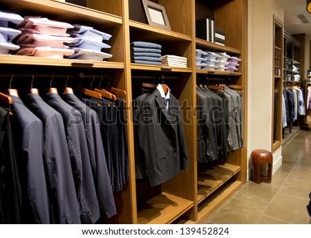 fashion clothing on hangers at the show - stock photo