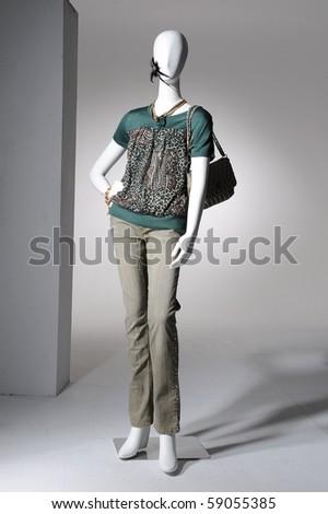 Fashion clothing on mannequin on light background - stock photo