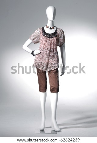 Fashion clothing on mannequin on light background - stock photo