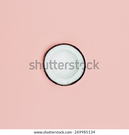 Fashion Coconut on pink background. Minimal style - stock photo
