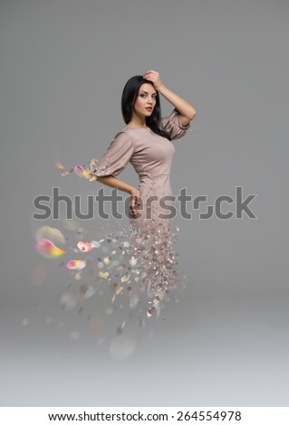 Fashion collage of beautiful woman fading in to pieces - stock photo