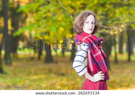 Fashion Concept and Ideas: Young Caucasian Female Brunette Woman in Made to Measure Clothing Standing in Autumn Forest Outdoors.Horizontal Image - stock photo