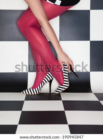 Fashion concept woman wearing high heels stilettos legs close up