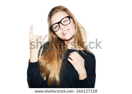 Fashion cool girl hipster in glasses. Woman giving the Rock and Roll sign . White background, not isolated - stock photo