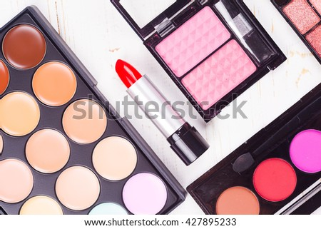Fashion cosmetic set on a white wooden background