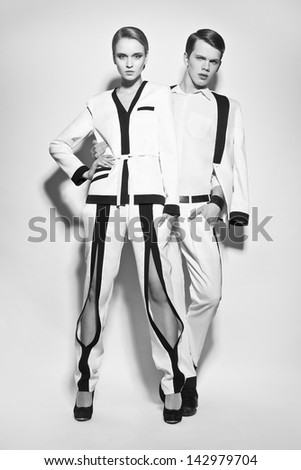 Fashion couple in white suite - stock photo