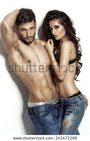 Fashion couple posing  - stock photo
