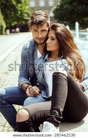 Fashion couple resting outdoor in summer time - stock photo