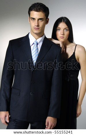 fashion couple, studio shot on white - stock photo