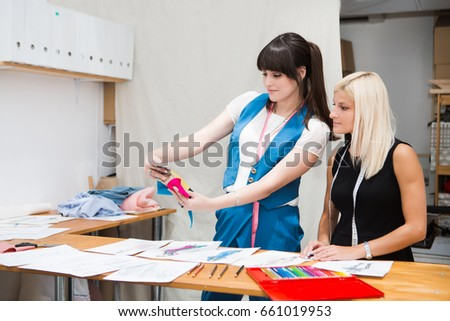 fashion designer studio. Two young entrepreneur women, and fashion designer working on her n designer studio.