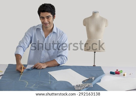 Fashion designer working in fashion studio - stock photo
