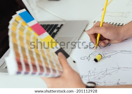 Fashion designer working with color samples - stock photo