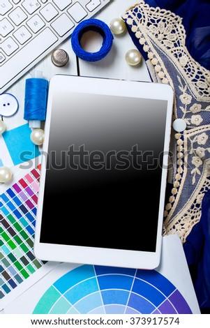 Fashion designer workspace with equipment - stock photo