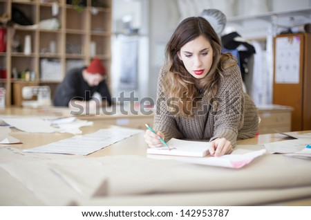 Fashion designers working in the studio
