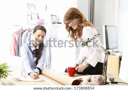 Fashion designers working together in their studio. - stock photo