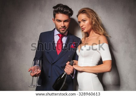 fashion elegant couple ready to drink champagne together to celebrate a birthday
