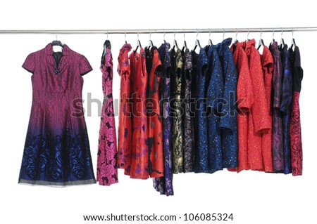 Fashion evening gown and coat clothing rack display