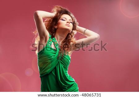 Fashion expressive girl dancing at disco light - stock photo