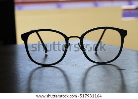 fashion eyeglasses on a balcony in the building with the purple background
