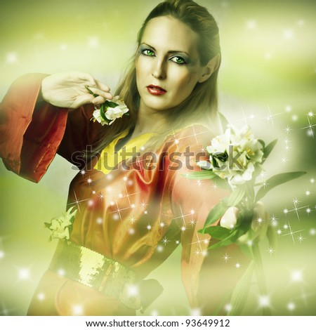 Fashion fantasy portrait of magic woman - fairytale forest elf with flower making magic - stock photo