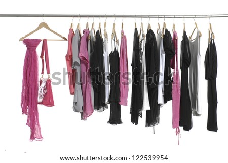 fashion female clothing and scarf with bag  hanging on hangers