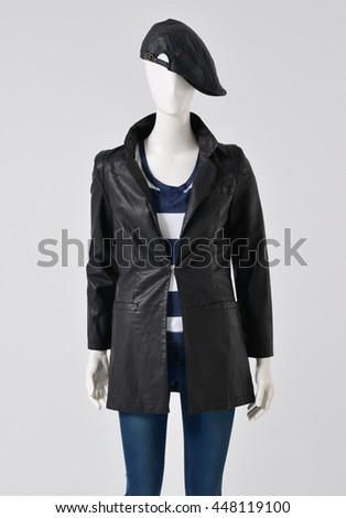 Fashion female clothing in black coat with hat on mannequin - stock photo