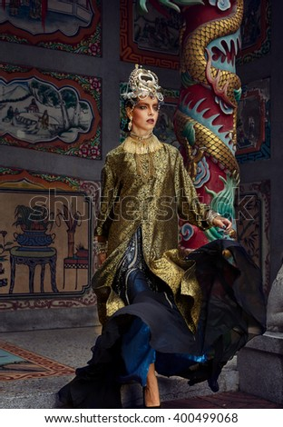 Fashion female model in china oriental vintage style dress, and artistick make up at the outdoor chinese temple - stock photo