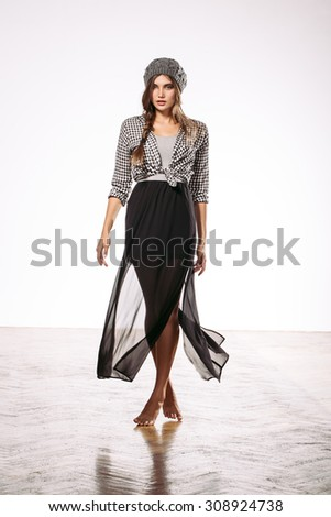 fashion female model posing on light background - stock photo