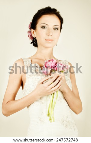 Fashion fiancee in vintage evening gown - stock photo