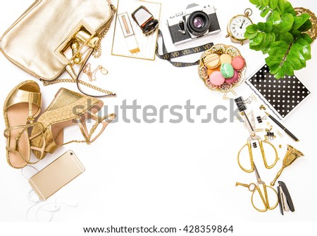 Fashion flat lay for bloggers social media. Feminine golden accessories, bag, shoes, office supplies, vintage photo camera and green plant on white background. Shopping. Social media flat lay - stock photo