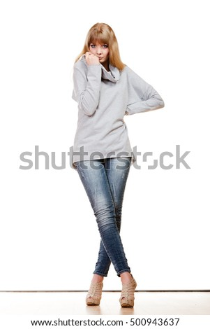 Fashion. Full body blonde fashionable woman jeans pants gray blouse. Female model posing isolated studio shot