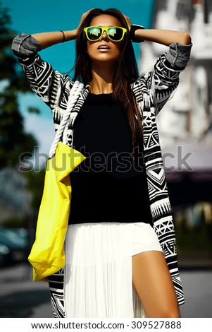 Fashion funny  glamor stylish sexy  beautiful  young woman model in hipster summer clothes  walking in the street with shopping bright yellow bag - stock photo