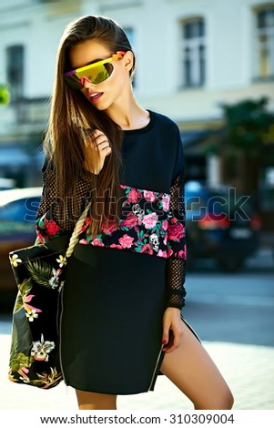 Fashion funny  glamor stylish sexy smiling  beautiful  young woman model in black hipster summer clothes  in the street after shopping - stock photo