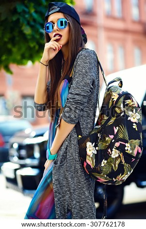 Fashion funny  glamor stylish sexy smiling  beautiful  young woman model in hipster summer clothes  in the street with bag - stock photo