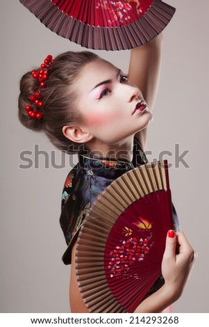 Fashion geisha dance in studio - stock photo