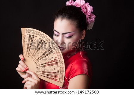 Fashion geisha in studio - stock photo