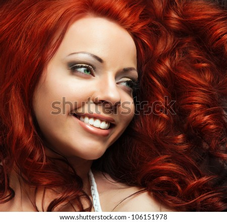 Fashion Girl. Beautiful Makeup and Healthy red Hair