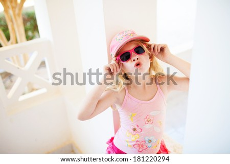 fashion girl by the wall - stock photo