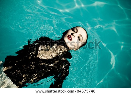 Fashion girl clothes in water