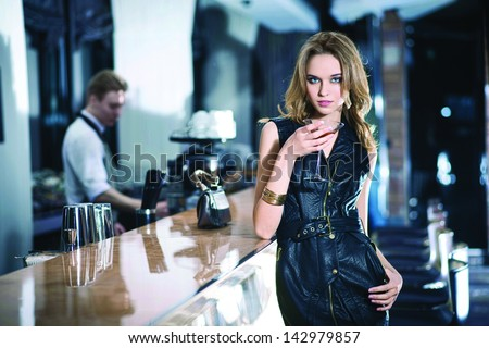 Fashion girl drinking a cocktail