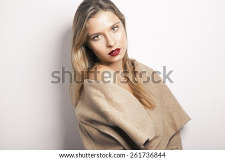 fashion girl in a coat. - stock photo