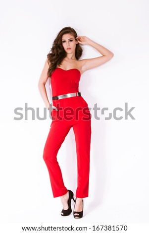 fashion girl in elegant red overalls and high heel shoes full body shot