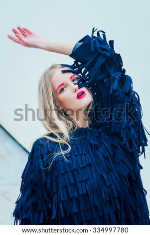 Fashion girl in he blue coat with pink eyebrows and lips - stock photo
