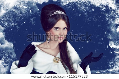 Fashion Girl in Luxury. Winter Queen present - stock photo