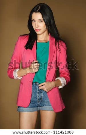Fashion girl in pink jacket and denim shorts - stock photo